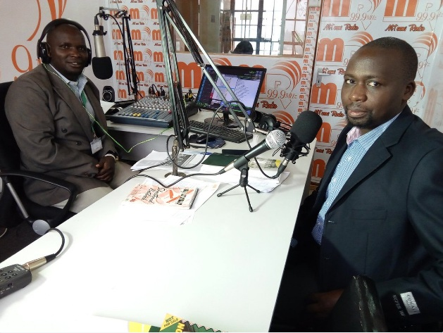 Geoffrey Kerosi and Kamadi Amata of Mtaani Radio discussing projects funded by Nairobi City Ward Development Fund