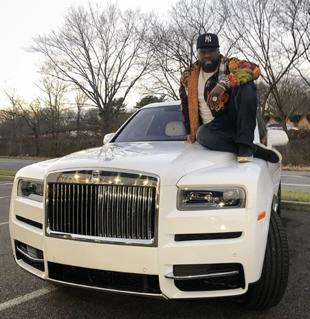 Rapper 50 Cent relaxing on his newly acquired Rolls Royce- a Christmas Grift for himself.