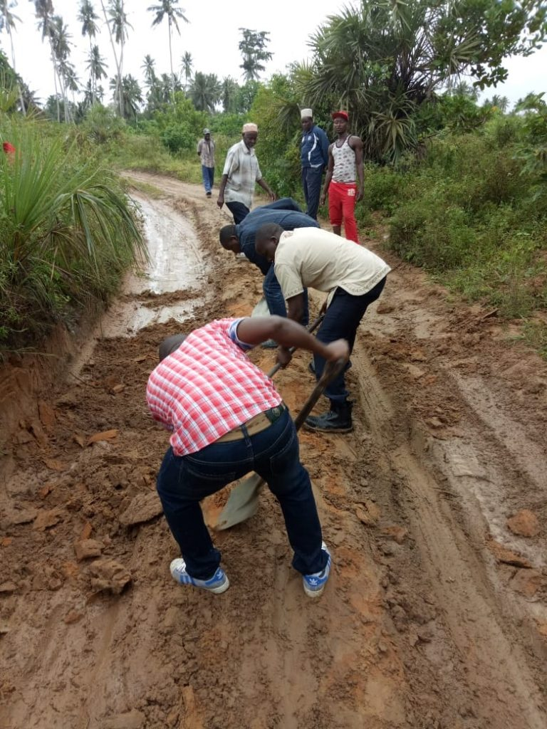This road in some village in Msambweni was terrible. We had to borrow spades and get into the work of making it passable.