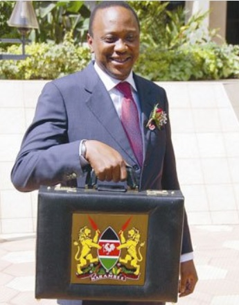 Uhuru Kenyatta as Finance Minister carrying the Budget briefcase.