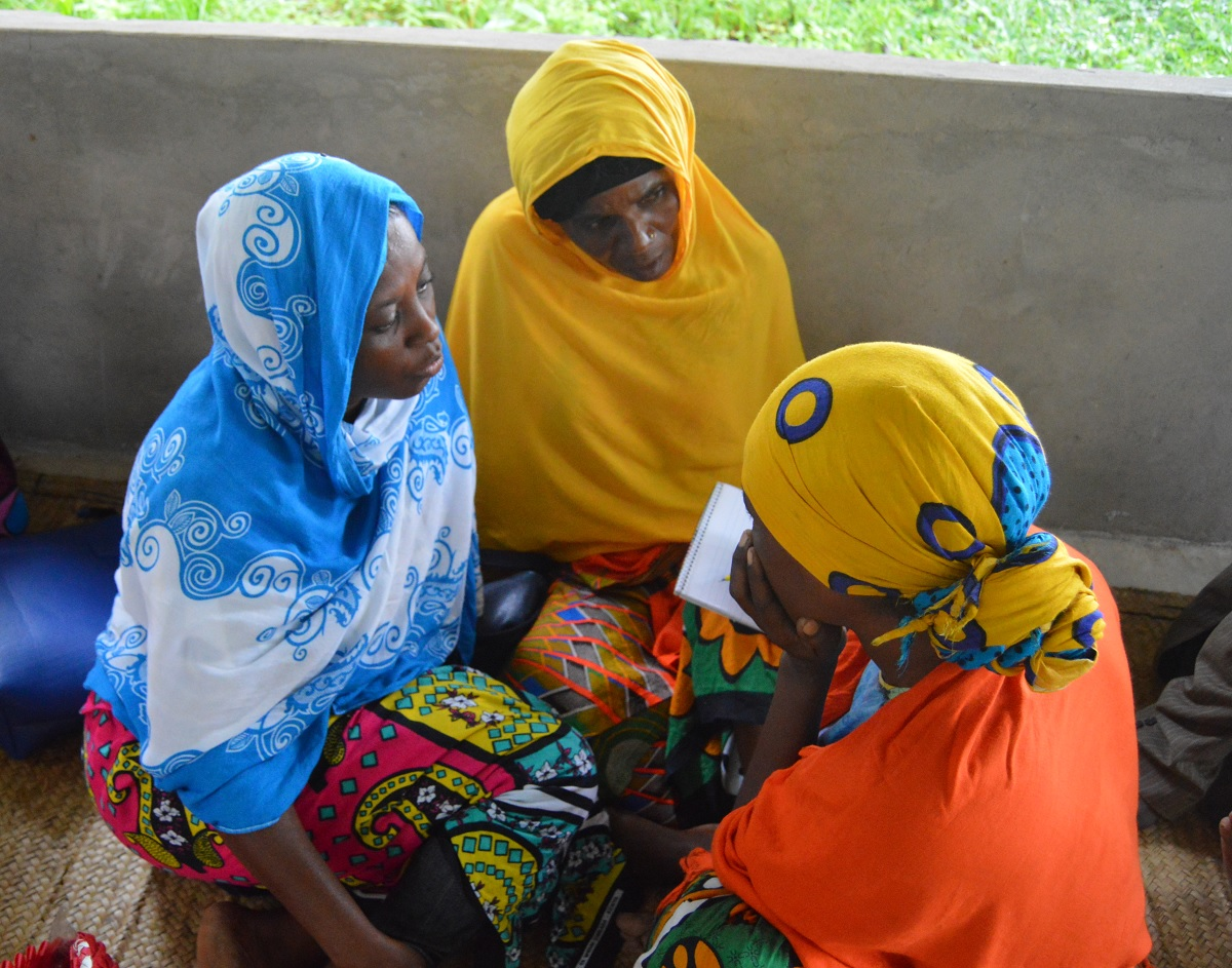 Women in a rural village in Kenya discussing issues of mining and their impact on their lives.