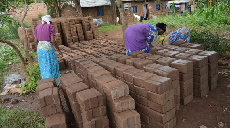 Residents of Bandani making interlocking blocks to be used for construction of low cost housing.