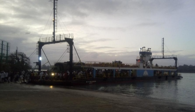 A saloon car reverses from Harambee ferry into the sea at Likoni Ferry Crossing