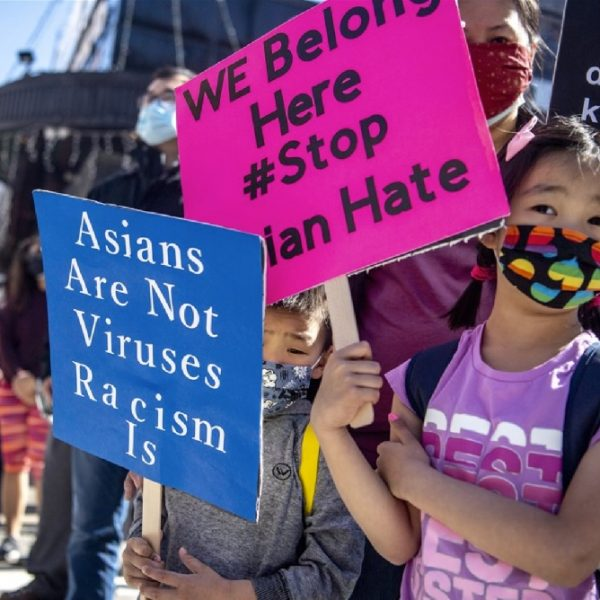 """Asians are not viruses, Racism is,"" placard read"