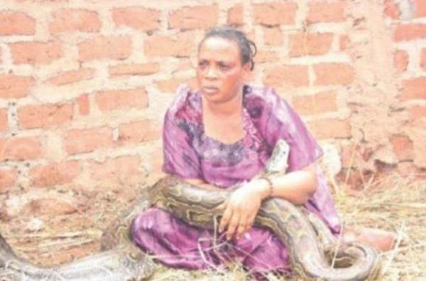 Woman caught breastfeeding a snake