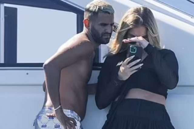 Riyad Mahrez, 30, of Manchester City holidays on a yacht in Spain with fiancée Taylor Ward, 23